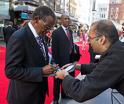 Image ©Licensed to i-Images Picture Agency. 10/06/2014. London, United Kingdom. HRH Prince Harry attends the 50th Anniversary of Zulu premiere. . Picture by Anthony Upton / i-Images<br /> Leicester Square, London, 10 June 2014: Pr. Buthelezi, who starred in the original film at a gala screening to celebrate the 50th Anniversary of Zulu where guests were joined by Prince Harry to watch a digitally remastered version of the iconic film. The evening was arranged to raise money for two charities supported by Prince Harry, Walking With The Wounded and Sentebale. <br /> For further info please contact<br /> Emily Conrad-Pickle Captive Minds<br /> Mobile: +44 (0)7799 414 790<br /> emily.conrad-pickles@captiveminds.com