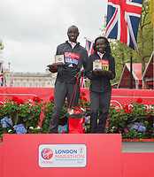 Daniel Wanjiru KEN and Mary Keitany KENstand on the podium following their victories in the Elite Men's and Women's Race. The Virgin Money London Marathon, 23rd April 2017.<br /> <br /> Photo: Ben Queenborough for Virgin Money London Marathon<br /> <br /> For further information: media@londonmarathonevents.co.uk