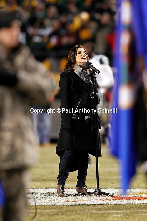 Singer Martina McBride sings the National Anthem prior to the Pittsburgh Steelers NFL 2011 AFC Championship playoff football game against the New York Jets on Sunday, January 23, 2011 in Pittsburgh, Pennsylvania. The Steelers won the game 24-19. (©Paul Anthony Spinelli)