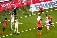 1. divisjon fotball 2018: Aalesund - Levanger (4-0). Aalesunds Holmbert Fridjonsson (t.h.) har akkurat satt inn 2-0 forbi keeper Julian Faye Lund i kampen i 1. divisjon i fotball mellom Aalesund og Levanger på Color Line Stadion. Pape Habib Gueye til venstre, Oddbjørn Lie i midten og Aron Elís Thrándarson bak.