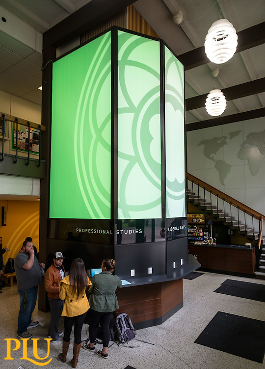 "Hauge entrance with the illuminated Rose Window wrap around the elevator and the remodeled area around including the ""Lute Cafe"" food cart at PLU, Monday, Oct. 3, 2016. (Photo: John Froschauer/PLU)"