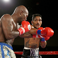Yamaguchi Falcao throws a right hand to the face of Taronze Washington during a Fire Fist Boxing Promotions boxing match at the A La Carte Pavilion on Saturday, August 12 , 2017 in Tampa, Florida.  (Alex Menendez via AP)