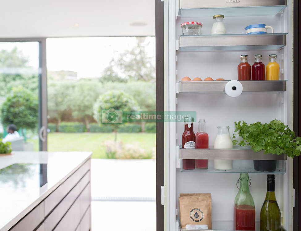 """September 5, 2017 - Inconnu, inconnu - 04/09/2017 - A spy camera for the fridge promises to make sure you NEVER run out of your essentials.Designed to save time, money, energy and food waste, the £100 GBP / €108 Euros / $130 USD wireless FridgeCam by UK company Smarter lets owners peek inside their fridge from a smartphone.Plenty of super pricey manufacturers have begun to offer fridges with build in cameras.But this is a fantastic way to make an ordinary, low-tech fridge work like a smart one at a fraction of the cost.Each time the fridge door is opened the FridgeCam automatically takes a snapshot of what's inside - sending it straight to a designated smartphone.It also uses object recognition to keep track of all food items, by sending an alert when they're about to expire.It will let people avoid making trips to the local grocery store or supermarket.It automatically adds favourite items to an in-app shopping list which will feature major supermarkets.Anyone left with an odd collection of ingredients toward the end of the week can use something called the """"Smarter Chef """" feature can even make recipe suggestions based on what's in there.The first time the fridge is filled with the camera inside, the user scans the barcodes of each item.The camera will learn what each object looks like and will automatically recognise it in the future.The inspiration behind the latest innovation in the kitchen was to combat the growing problem of food waste in the home.The FridgeCam comes after it was revealed the UK throws away 7.3 million tonnes of food in a year.The FridgeCam will be in shops in October. # INSOLITE - UNE CAMERA CONTRE LE GASPILLAGE DANS VE FRIGO (Credit Image: © Visual via ZUMA Press)"""