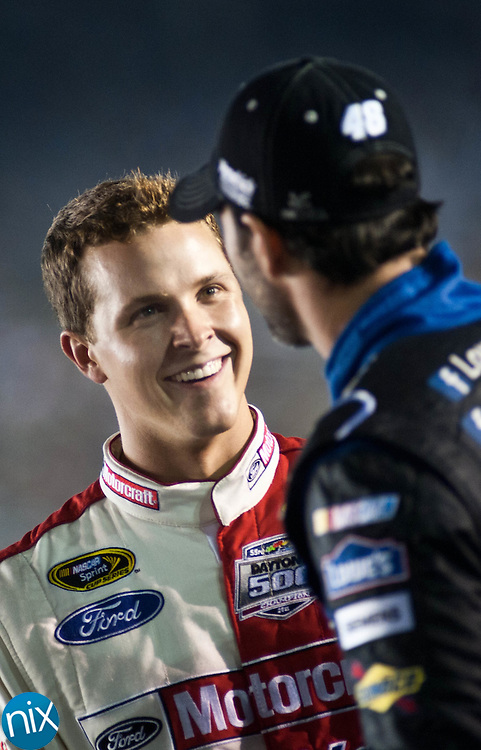 Trevor Bayne talks with Jimmie Johnson prior to qualifying for the Bank of America 500 during  Bojangles Pole Night at Charlotte Motor Speedway Thursday night. (Photo by James Nix)