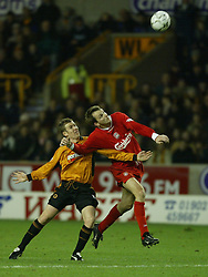 WOLVERHAMPTON, ENGLAND - Wednesday, January 21st, 2004: Liverpool's Dietmar Hamann and Wolverhampton Wanderers' Kenny Miller during the Premiership match at Molineux. (Pic by David Rawcliffe/Propaganda)