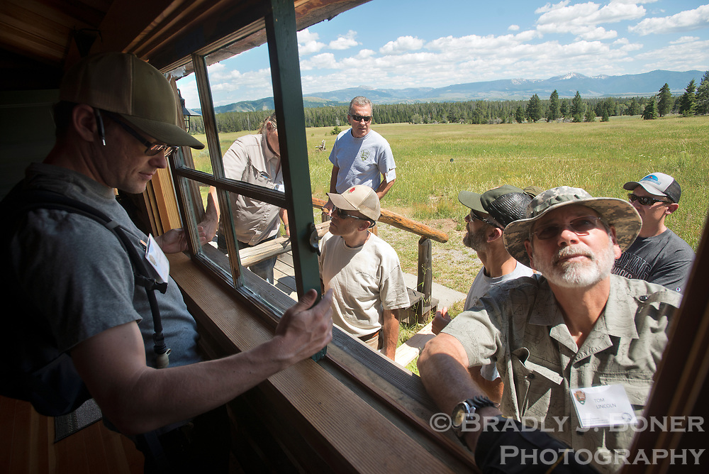 Kevin Brothers, left, and Tom Lincoln remove a window from one of the guest cabins at the White Grass Ranch on July 12 as part of a window and door restoration workshop. The ranch has become the headquarters for the Western Center for Historic Preservation, where participants come from national parks around the country and learn restoration and preservation skills to take back to their respective park or monument.