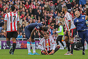Sunderland forward, on loan from Rennes, Ola Toivonen has to go off injured  during the Barclays Premier League match between Sunderland and Newcastle United at the Stadium Of Light, Sunderland, England on 25 October 2015. Photo by Simon Davies.