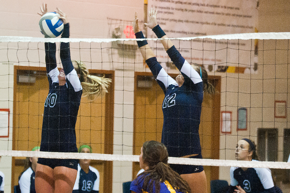 Lathan Goumas | The Bay City Times..Ella Giles of Heritage High School blocks the ball during a quad volleyball match at Garber High School in Essexville, MI., on Thursday September 29, 2011.