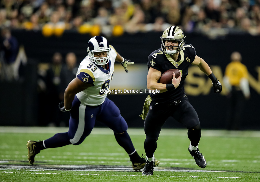 Nov 4, 2018; New Orleans, LA, USA; New Orleans Saints quarterback Taysom Hill (7) runs past Los Angeles Rams nose tackle Ndamukong Suh (93) during the first quarter at the Mercedes-Benz Superdome. Mandatory Credit: Derick E. Hingle-USA TODAY Sports