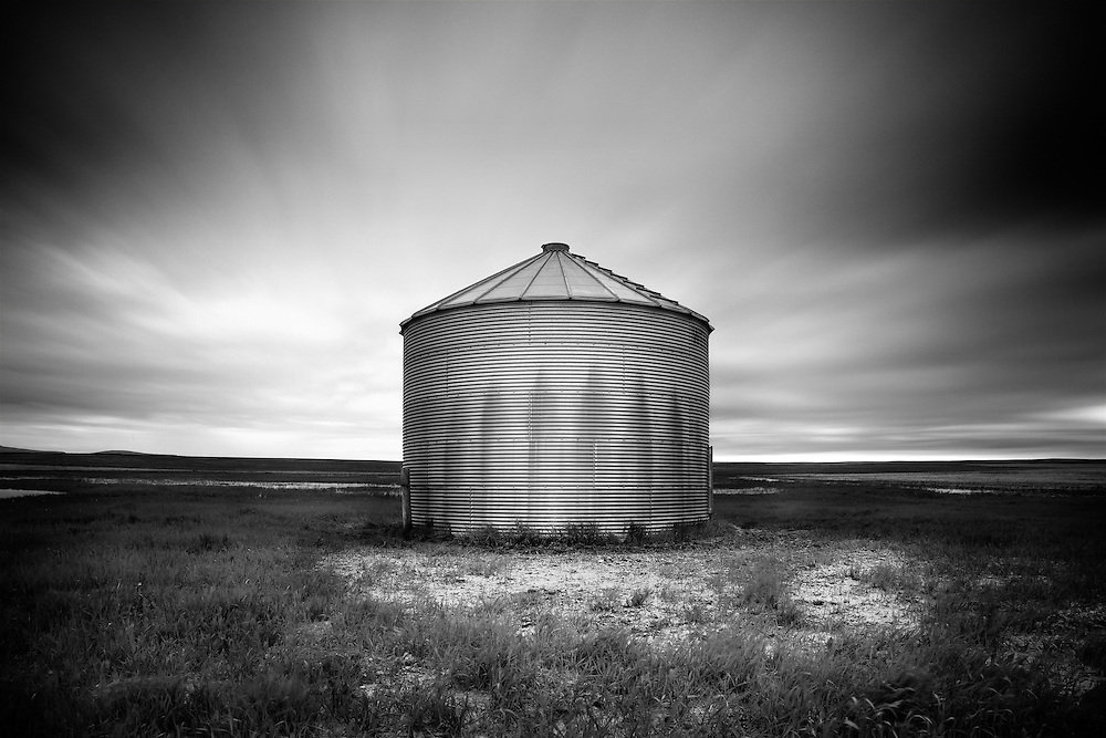 Long exposure of a grain silo and fast moving rain clouds.