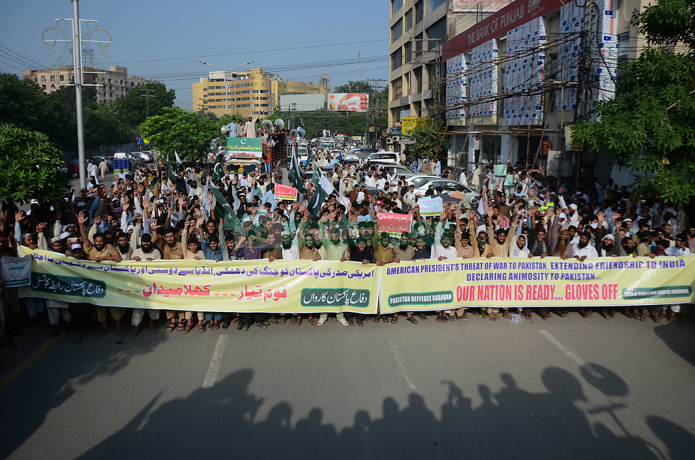 August 26, 2017 - Lahore, Punjab, Pakistan - Pakistani Activists of Difa-e-Pakistan Council (DPC) chant slogans during protest rally to condemn American President Donald Trump's accusations in Lahore on August 25, 2017. American President Donald Trump's accusations that Islamabad takes billions of dollars in aid money from Washington and helps militants plotting deadly terrorist attacks against American troops in Afghanistan, outside American Consulate. (Credit Image: © Rana Sajid Hussain/Pacific Press via ZUMA Wire)
