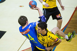 Sebastian Skube of Celje PL and Luka Dobelsek of Gorenje during handball match between RK Gorenje Velenje and RK Celje Pivovarna Lasko in Final match of 1st NLB League - Slovenian Championship 2013/14 on May 23, 2014 in Rdeca dvorana, Velenje, Slovenia. Photo by Vid Ponikvar / Sportida