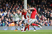 Nottingham Forest midfielder Henri Lansbury (10) scoring penalty 0-2 during the Sky Bet Championship match between Fulham and Nottingham Forest at Craven Cottage, London, England on 23 April 2016. Photo by Matthew Redman.