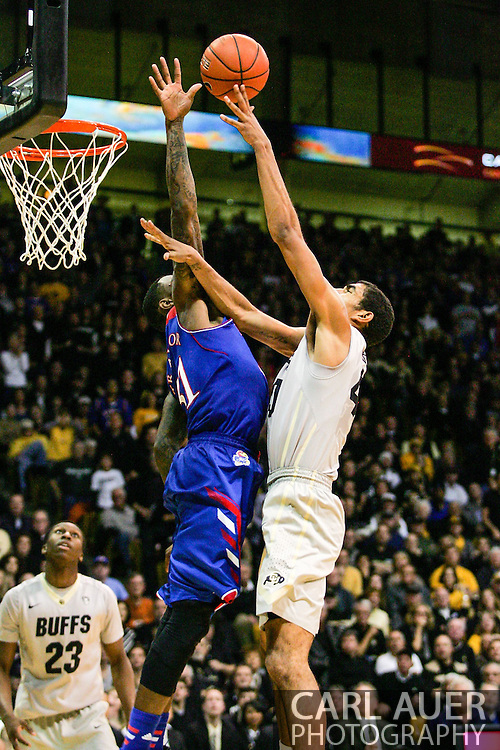 December 7th, 2013:  Colorado Buffaloes sophomore forward Josh Scott (40) takes a shot over Kansas Jayhawks redshirt sophomore forward Jamari Traylor (31) in the second half of action in the NCAA Basketball game between the Kansas Jayhawks and the University of Colorado Buffaloes at the Coors Events Center in Boulder, Colorado