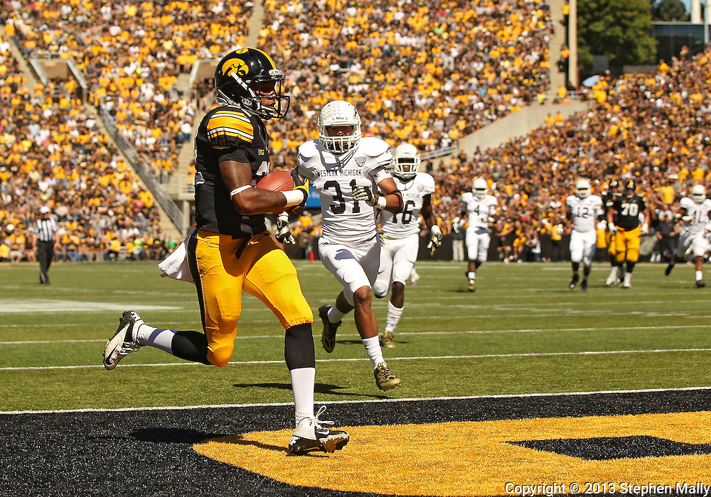 September 21 2013: Iowa Hawkeyes wide receiver Damond Powell (22) runs into the end zone for a touchdown on a 29 yard reception as Western Michigan Broncos cornerback Leo Alba (31) gives chase during the third quarter of the NCAA football game between the Western Michigan Broncos and the Iowa Hawkeyes at Kinnick Stadium in Iowa City, Iowa on September 21, 2013. Iowa defeated Western Michigan 59-3.