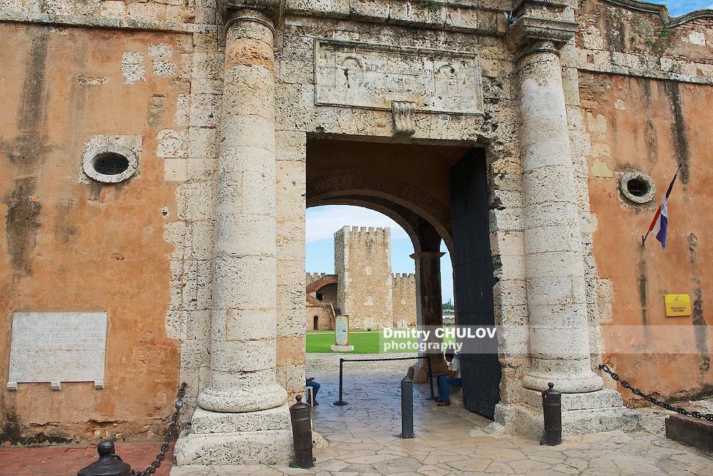 SANTO DOMINGO, DOMINICAN REPUBLIC - NOVEMBER 07, 2012: Exterior of the entrance gate to the Ozama Fortress in Santo Domingo, Dominican Republic. UNESCO World Heritage site.