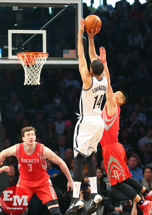 Apr 1, 2014; Brooklyn, NY, USA; Brooklyn Nets guard Shaun Livingston (14) shoots the ball over Houston Rockets guard Jeremy Lin (7) during the first quarter at Barclays Center.