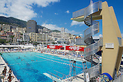 MONACO, MONACO - JUNE 17, 2015: Unidentified people swim and sunbathe at the open air public swimming pool in Monaco.