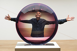 © Licensed to London News Pictures. 25/09/2018. London, UK. Artist Fred Eversley with his untitled artwork (Parabolic Lens), 1971 showing as part of the Shape Shifters Exhibition at the Haywood Gallery. Photo credit: Ray Tang/LNP