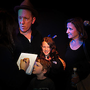 Buffalo Tom's Bill Janovitz is interviewed after the show while his family looks on.