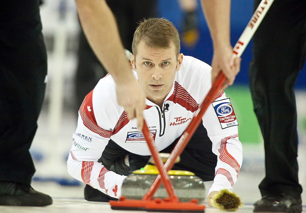 Canadian skip Jeff Stoughton delivers his stone during Canada's 5-2 victory over Scotland in the 1-2 playoff match at the Ford World Men's Curling Championships in Regina, Saskatchewan, April 8, 2011.<br /> AFP PHOTO/Geoff Robins