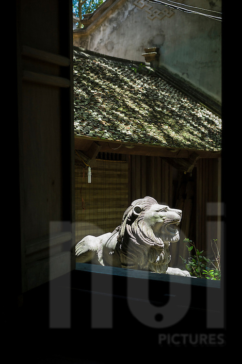Lion statue in Thay buddhist pagoda, Quoc Oai district, Hanoi, Vietnam, Southeast Asia