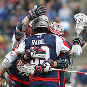 Paul Rabil #99 of the Boston Cannons and other members of the Boston Cannons during the game at Harvard Stadium on April 27, 2014 in Boston, Massachusetts. (Photo by Elan Kawesch)