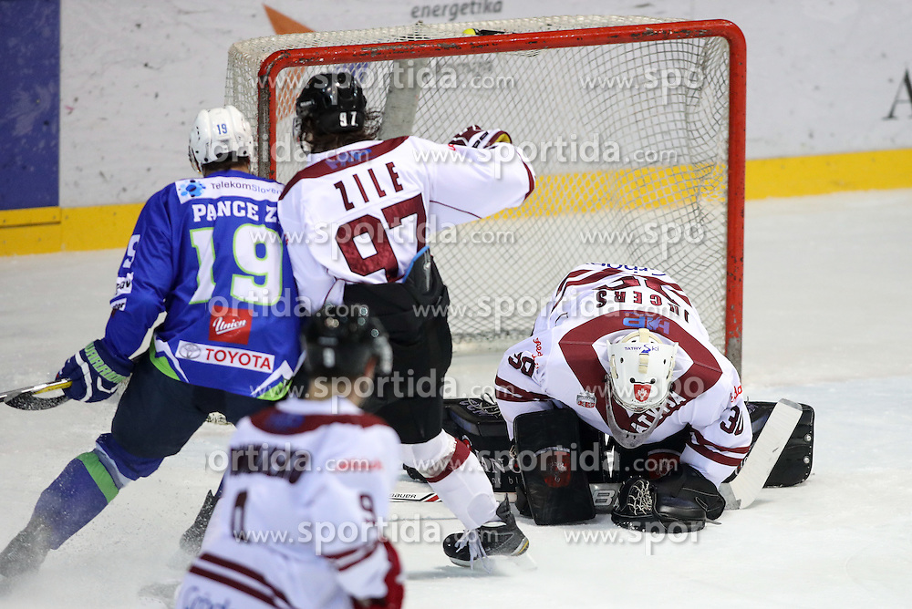 Ziga Pance of Slovenia and Maris Jucers of Latvia during ice hockey match between Latvia and Slovenia at EIHC tournament Bled 2016, on November 3, 2016 in Ledena dvorana Bled, Bled, Slovenia. Photo by Morgan Kristan / Sportida