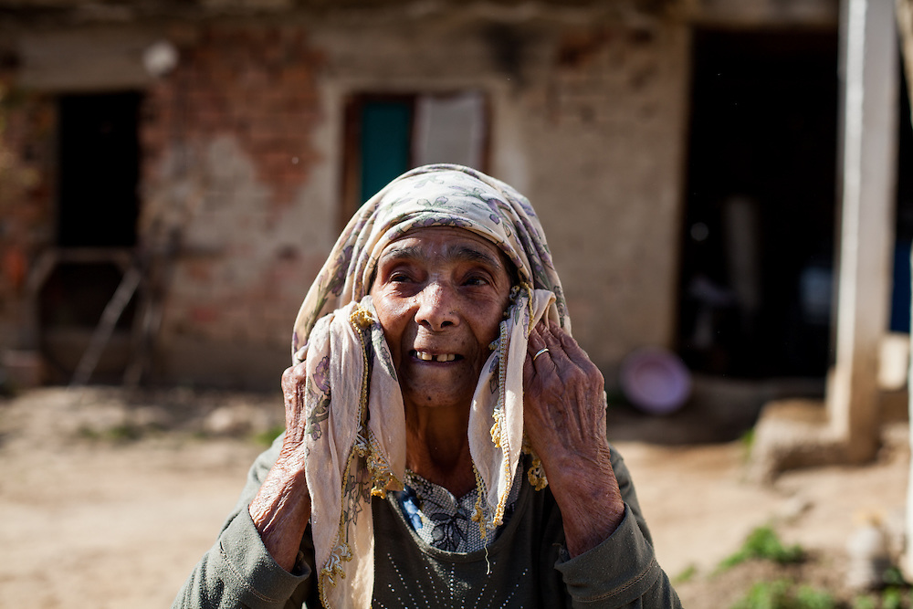 Demirov Dyinei's grandmother preparing herself for a portrait at the Roma part of the city of Crnik.