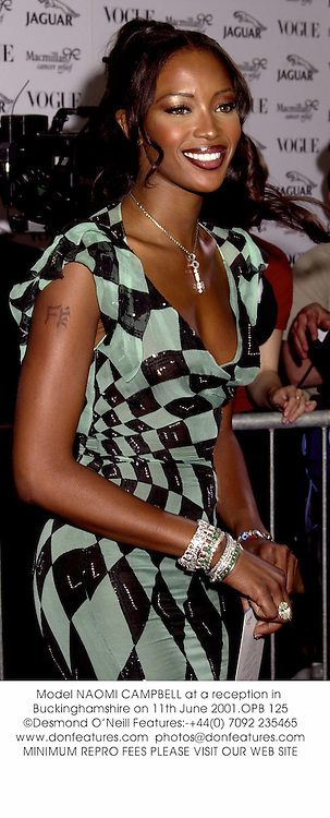 Model NAOMI CAMPBELL at a reception in Buckinghamshire on 11th June 2001.OPB 125