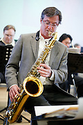Tim McNally of Chops Big Band Jazz plays the saxophone during the Tribute Celebration for former Mayor Ben Gross at the Sandra Lee Senior Center in Milpitas, California, on February 23, 2013. (Stan Olszewski/SOSKIphoto)