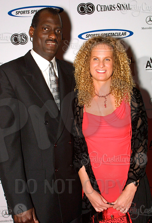Jun 30, 2002; Los Angeles, California, USA; WNBA head coach MICHAEL COOPER with swedish girlfriend Yvonne Soderberg arrive at the 17th annual Cedars-Sinai Sports Spectacular at the Century Plaza Hotel in Century City. <br />