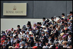 Racegoers watch the Queen and the Duke of Edinburgh arrive for the last day of Royal Ascot, Saturday June 18, 2011 Photo By Andrew Parsons/i-images