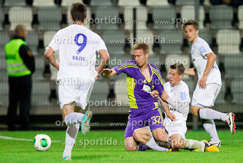 Robert Beric #32 of Maribor vs Miha Zajc #28 of Celje  during football match between NK Maribor and NK Celje in final of Slovenian Cup 2013 on May 29, 2013 in Stadium Bonifika, Koper, Slovenia. (Photo By Vid Ponikvar / Sportida)