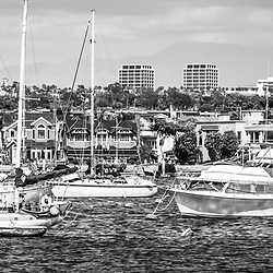 Newport Beach skyline panorama photo in black and white. Panoramic picture ratio is 1:3 and Includes boats in Newport Harbor (Newport Bay) with Newport Beach Fashion Island office buildings in the background.