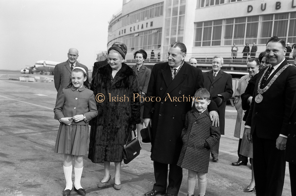 15/03/1964<br /> 03/15/1964<br /> 15 March 1964<br /> Taoiseach Sean Lemass leaves for London to open Irish Week at the London Office of Coras Trachtala and to attend the St. Patrick's night dinner of the N.U.I. Club in London. Picture shows Mr Sean Lemass TD, and Mrs Kathleen Lemass leaving Dublin Airport to board their flight. Lord Mayor of Dublin, Sean Moore on right.