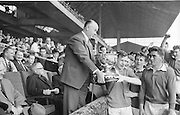 President of GAA Aodh O'Broin presents minor cup to Kerry Captain S.O'Mahoney at the All Ireland Minor Gaelic Football Final Kerry v Mayo in Croke Park on the 23rd September 1962. Referee: E. Moules (Wicklow) Attendance: 75,771.