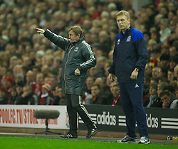 LIVERPOOL, ENGLAND - Tuesday, March 13, 2012: Liverpool's manager Kenny Dalglish and Everton's manager David Moyes during the Premiership match at Anfield. (Pic by David Rawcliffe/Propaganda)
