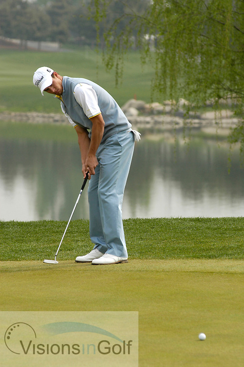 23 April 2005. Johnnie Walker Classic, Pine Valley Golf Club, Beijing, China. Adam Scott putts for eagle on the par-five 8th.<br /> Mandatory credit: Richard Castka/Visions In Golf