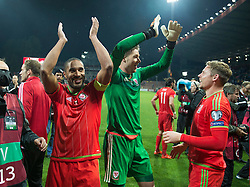 ZENICA, BOSNIA & HERZEGOVINA - Saturday, October 10, 2015:Wales Ashley Williams and Wales goalkeeper Wayne Hennessey celebrate after securing a place at next years Euro Championships after the Bosnia & Herzegovina vs Wales match at the Stadion Bilino Polje during the UEFA Euro 2016 qualifying Group B match. (Pic by Peter Powell/Propaganda)