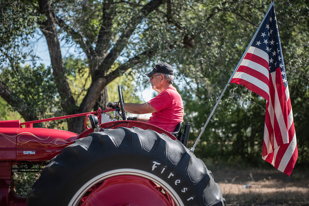 rer070417i/metro/July 04, 2017/Albuquerque Journal<br /> Ross Howard(Cq)begins to drive his tractor during the 4th of July parade through the town of Corrales Tuesday morning. Howard belong to the Corrales Tractor Club. <br /> Albuquerque, New Mexico Roberto E. Rosales/Albuquerque Journal