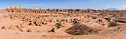 A panorama of hoodoos (mushroom-shaped rock pinnacles) fills Goblin Valley State Park, in the San Rafael Swell, Utah, USA. The park is in Emery County between the towns of Green River and Hanksville in central Utah. The Goblin rocks eroded from Entrada Sandstone, which is comprised of alternating layers of sandstone (cross-bedded by former tides), siltstone, and shale debris which were eroded from former highlands and redeposited in beds on a former tidal flat. Mount Ellen, at the northern end of the Henry Mountains, rises on the right (south). This panorama was stitched from 6 overlapping photos.