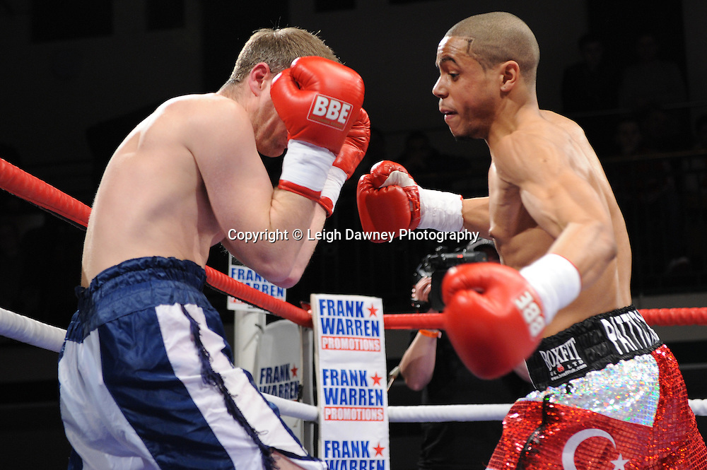Welterweight Ahmet Patterson (silver/red shorts)defeats Wayne Downing at York Hall, Bethnal Green, London on the 19th February 2011. Frank Warren Promotions. Photo credit © Leigh Dawney.
