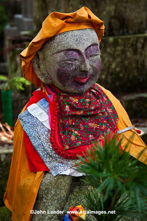 Jizo at Okunoin - considered one of the most sacred places in Japan surrounded by Japan's largest graveyard. People from all over Japan, who wish to be buried close to Kobo Daishi lie here including former feudal lords, politicians and other prominent personalities. Their graves line the approache to Okunoin through the forest.
