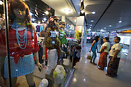 YANGON, MYANMAR - SEPTEMBER 20, 2012.Women wearing traditional longyi look at modern show window at shopping mall in Yangon, Myanmar on Sep 20, 2012..After nearly five decades where the military had tight control over people's lives, the arrival of democracy has led to debates about a new national identity for the country..(Photo by Kuni Takahashi).