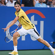 DOMINIC THIEM chases down a ball during his match on day four at the Citi Open at the Rock Creek Park Tennis Center in Washington, D.C.