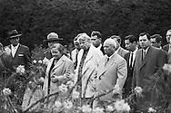 1959. Madame Eleanor Roosevelt walking along side Nikita Khrushchev, showing him the Roosevelt Library memorial grounds.<br /> Behind Khrushchev you can see the Russian foreign minister, Andrei Gromyko.<br /> <br /> 1959.  Eleanor Roosevelt marchant au c&ocirc;t&eacute; de Nikita Khrouchtchev, lui montrant le jardin comm&eacute;moratif de la librairie Roosevelt  .<br /> Derri&egrave;re Khrouchtchev, vous pouvez voir le ministre russe des Affaires &eacute;trang&egrave;res, Andrei Gromyko .