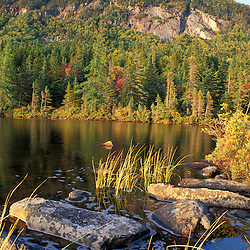 White Mountains. Appalachian Trail. Ethan Pond and the cliffs of Mt. Willey on an early fall day. Ethan Pond, NH