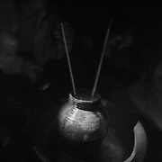 """Ruou can (rice liquor) at the """"bomb village"""" of Ban Senphen. The village is located in the Ban Phanhop valley, one of the """"chokes"""", or narrow corridors along the Ho Chi Minh Trail in Laos that were heavily bombed by American forces during the Vietnam War."""