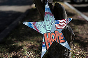 "DALLAS, TX - AUGUST 11: A sign for ""Hope"" hangs on a tree outside the Southwest Patrol Division in Dallas, Texas on August 11, 2016. (Photo by Cooper Neill for The Washington Post)"